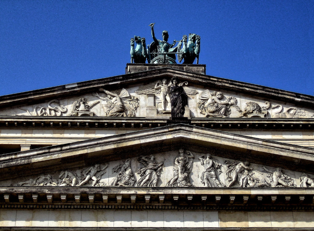 Karl Friedrich Schinkel - Architect, Christian Daniel Rauch and Friedrich Tieck - sculptors, Schauspielhaus Ostgiebel Konzerthaus, concert hall Berlin, Tympanums above the main entrance Sculptures created by Christian Friedrich Tieck about 1820
